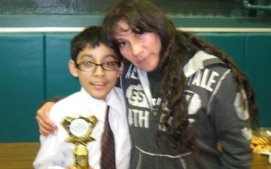 CSF Scholar Uziel Dominguez being congratulated by his mother, Isabel, after placing third in a speech contest in March, 2013. Uziel will begin his freshman year at Regis High School in a few weeks.